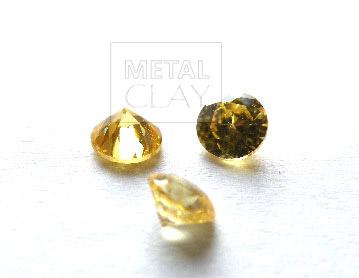 cyrkonia okrągła gold 4 mm